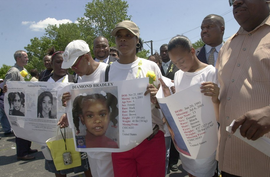 The family of Diamond and Tionda Bradley, sisters who went missing in Chicago 15 years ago and have never been found, hold a 2004 vigil to mark the three-year anniversary of the girls' disappearance. - BRIAN JACKSON/SUN-TIMES