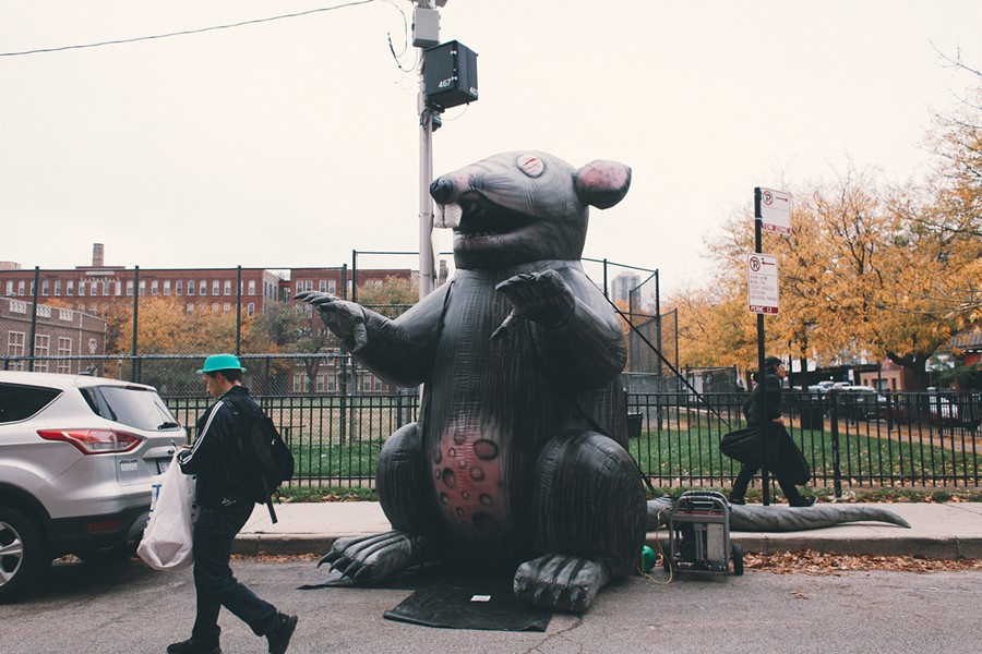 Stinky the Riv Rat keeps an eye on the protest. - DANIELLE A. SCRUGGS