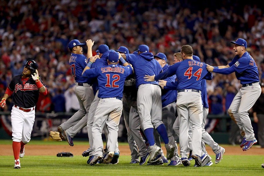 The Cubs celebrate after the last out Wednesday night. - ELSA/GETTY IMAGES