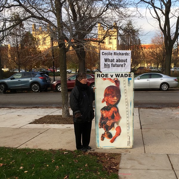 A protester outside the law school - AIMEE LEVITT