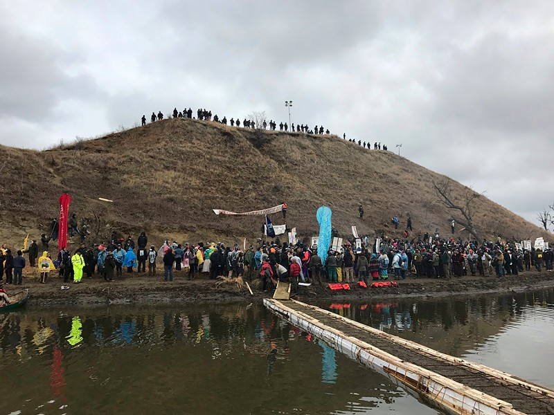 Dakota Access Pipeline protesters gather on and around Turtle Island, a site they say is home to tribal burial sites. - NANCY TREVINO VIA AP