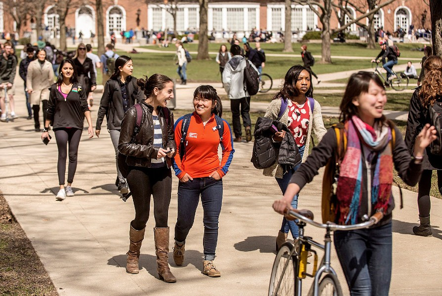Students walk across the quad on the University of Illinois campus in Urbana. - HEATHER COIT /THE NEWS-GAZETTE VIA AP, FILE
