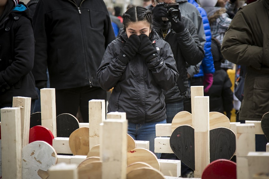 Family members of the nearly 780 people lost to gun violence in 2016 marched on Michigan Avenue December 31. - ASHLEE REZIN/SUN-TIMES