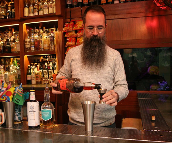 Paul McGee pours OFTD rum to make a cocktail - JULIA THIEL