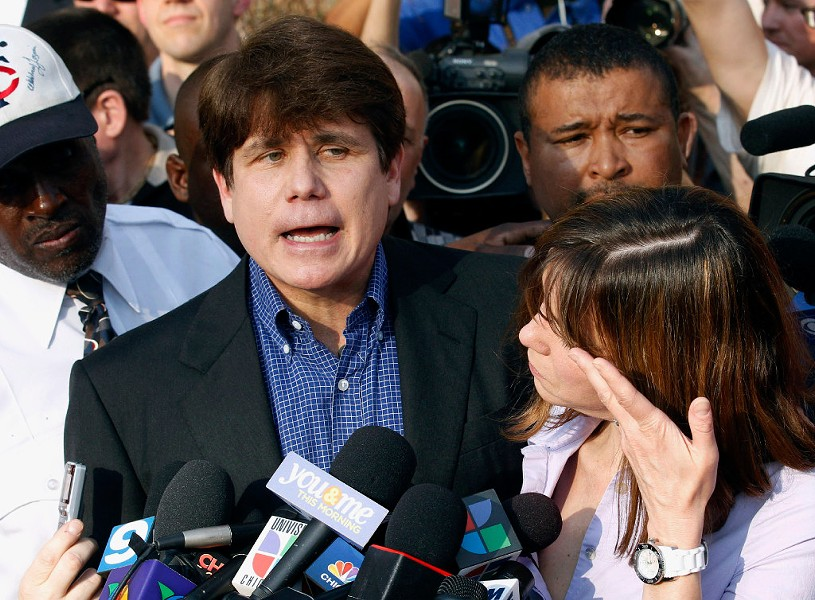 In a file photo from March 2012, former governor Rod Blagojevich speaks to the media the day before reporting to federal prison, flanked by his wife, Patti. - AP PHOTO/M. SPENCER GREEN