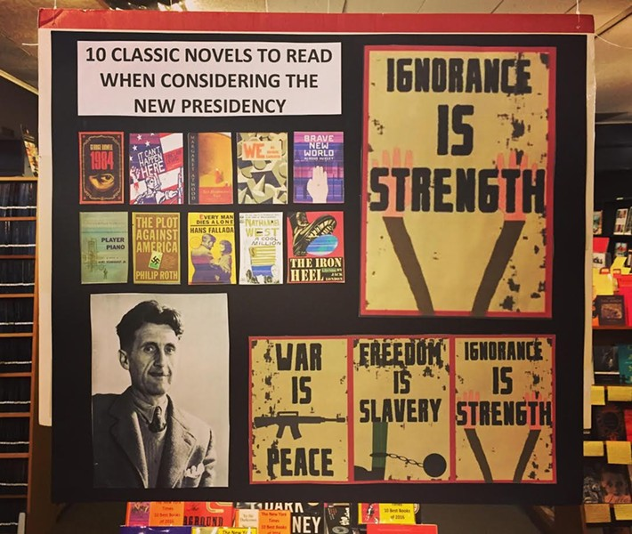 A placard in Lakeview's Unabridged Bookstore suggests a host of classic dystopian novels for this political moment. - COURTESY OF UNABRIDGED BOOKSTORE