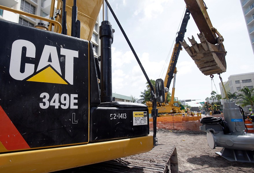 A Caterpillar 349E hydraulic excavator operates on a construction site. - AP PHOTO/WILFREDO LEE, FILE