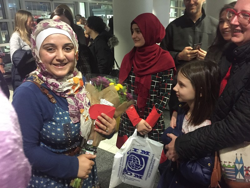 Baraa, left, a Syrian refugee, was greeted at O'Hare Tuesday night by her family and American sponsors. - JIMS PORTER