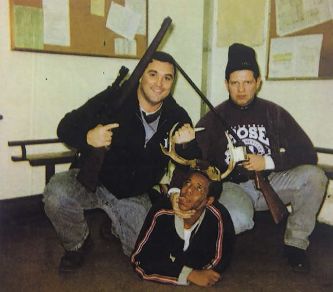 Herbert represented CPD detective Timothy McDermott, right, after a 2002 photo surfaced showing McDermott posing with fellow officer Jerome Finnigan, left, and a black arrestee later identified as 18-year-old Michael Spann. The photo was widely cited as an example of CPD's deep-rooted racism. - COURT FILE