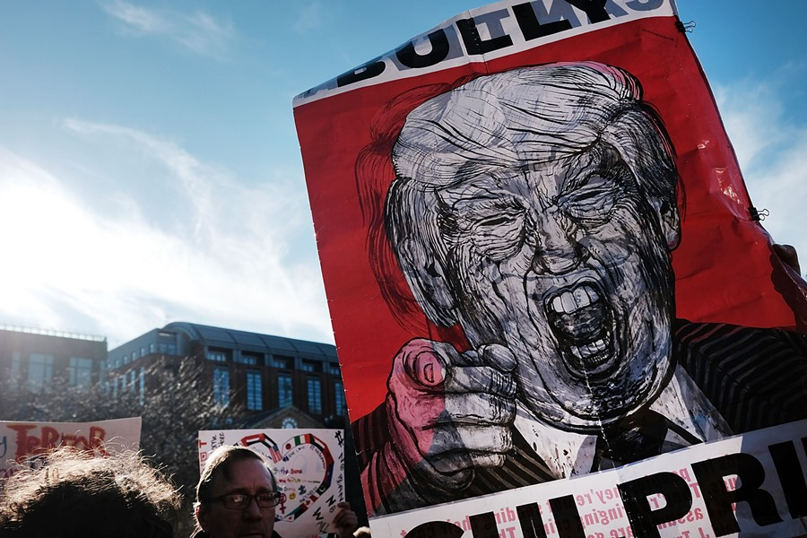 Protesters critical of President Donald Trump attended a rally and general strike in New York's Washington Square Park Friday. - SPENCER PLATT/GETTY IMAGES