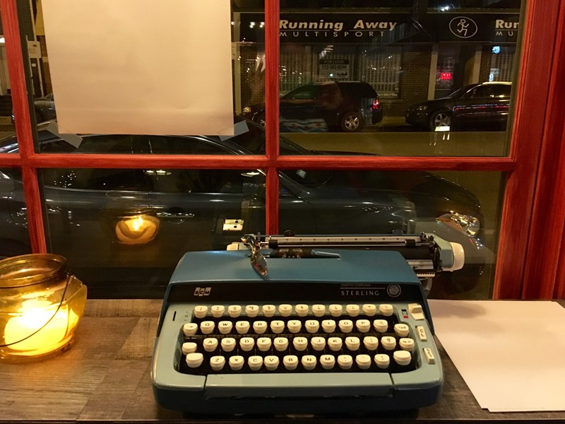 Patrons are encouraged to write with a provided typewriter. - AIMEE LEVITT