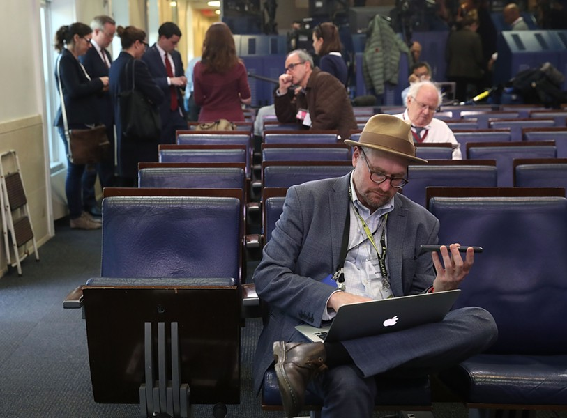 New York Times reporter Glen Thrush works in the White House briefing room after being excluded from an off-camera press gaggle by White House press secretary Sean Spicer Friday. The Los Angeles Times, CNN, and Politico were also excluded. - MARK WILSON/GETTY IMAGES
