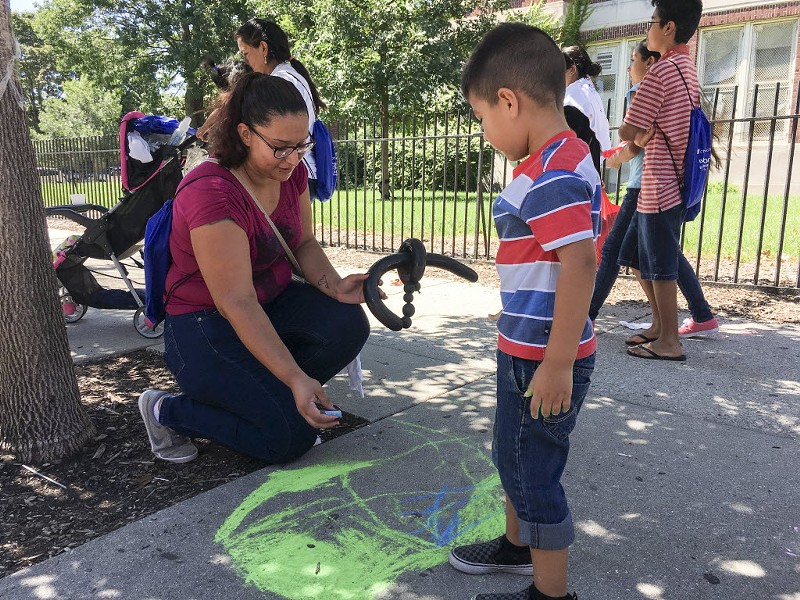 Ana Correa draws with her son Bylan at a CPS back-to-school celebration in August 2016. - JACOB WITTICH/SUN-TIMES