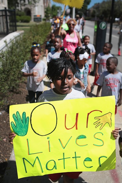 Students from Parkside Community Academy march against violence in South Shore in June 2016. Trump's proposed budget cuts would target health and safety initiatives for low-income youth. - SCOTT OLSON/GETTY IMAGES