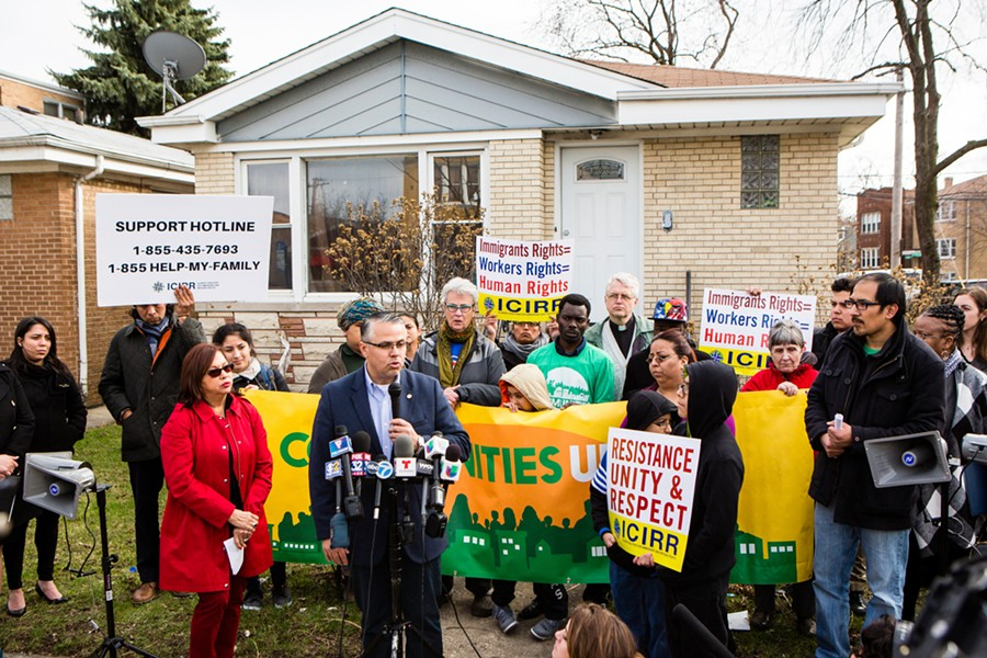 Thirty-sixth Ward alderman Gilbert Villegas speaks at a gathering of Belmont Cragin residents Tuesday, demanding an investigation into the shooting of a 53-year-old man shot in his home by federal immigration agents. - JAMES FOSTER/FOR THE SUN-TIMES