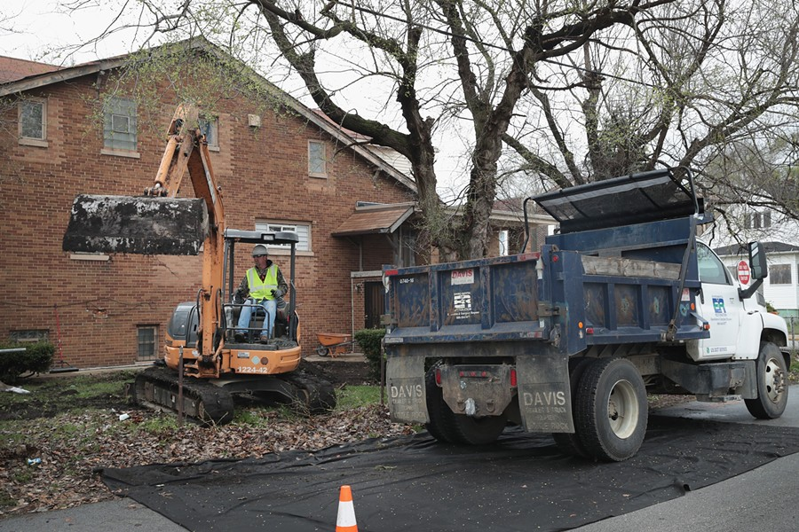 Workers remove lead-tainted topsoil from the yard of an East Chicago home near where U.S. EPA administrator Scott Pruitt met with area residents and community leaders Wednesday. - SCOTT OLSON/GETTY IMAGES
