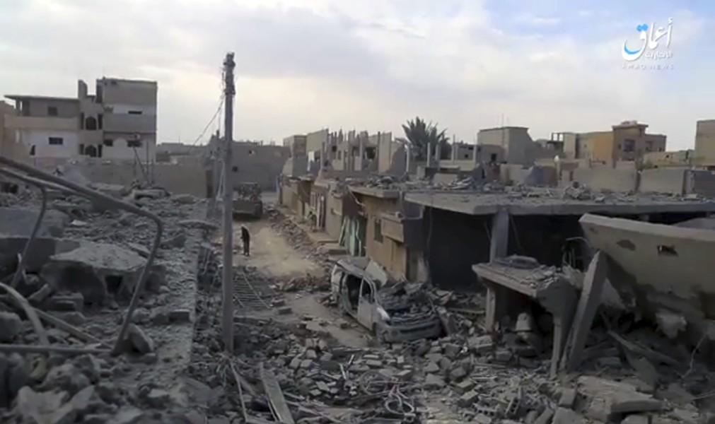 A video posted online April 18 by the media arm of the Islamic State group purports to shows destroyed houses following a U.S.-led coalition strike in the eastern Syrian town of Boukamal. - AAMAQ NEWS AGENCY VIA AP