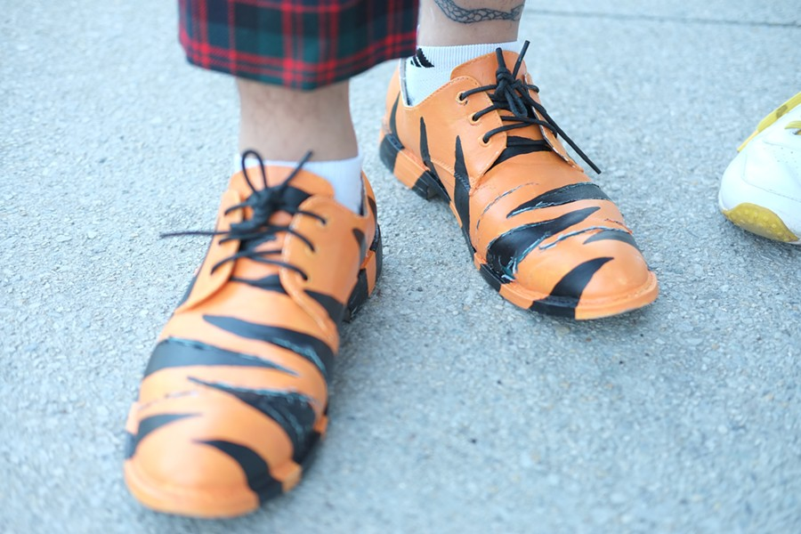 Anwar painted the tiger pattern on his shoes himself. - ISA GIALLORENZO