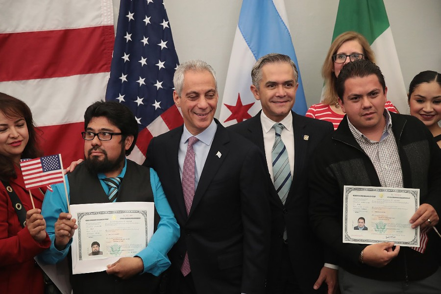 Mayor Rahm Emanuel and Mexico City mayor Miguel Mancera pose for pictures with newly naturalized citizens following a ceremony in Chicago earlier this year. - PHOTO BY SCOTT OLSON/GETTY IMAGES