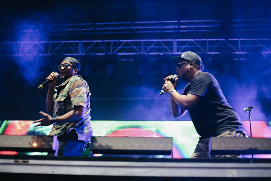 Q-Tip and Jarobi White with Phife Dawg's mike stand - ZAKKIYYAH NAJEEBAH