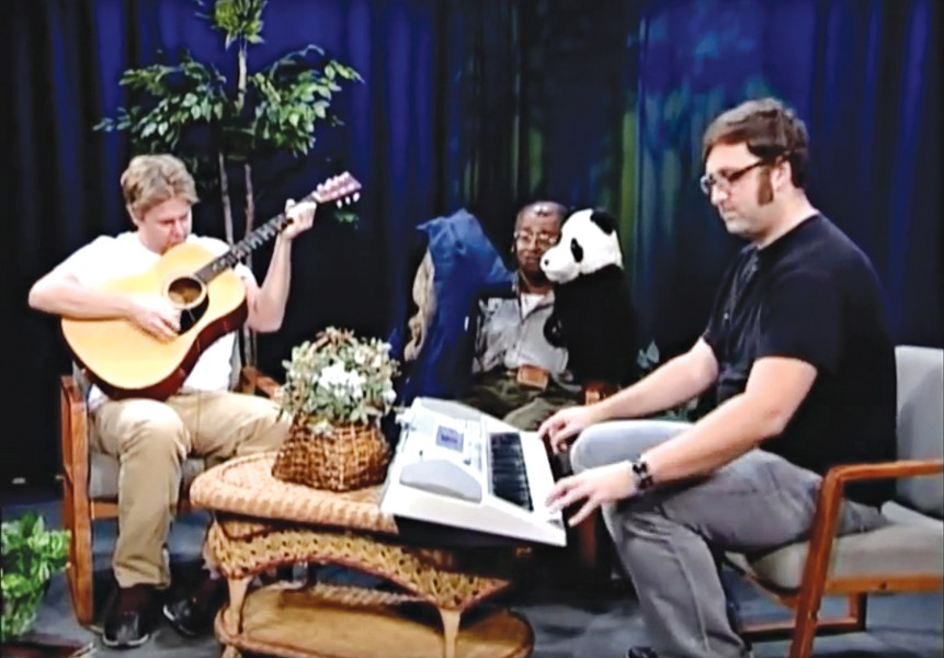 Tim Heidecker (left) and Eric Wareheim (right) accompany amateur puppeteer David Liebe Hart on an episode of Tim and Eric Awesome Show, Great Job!