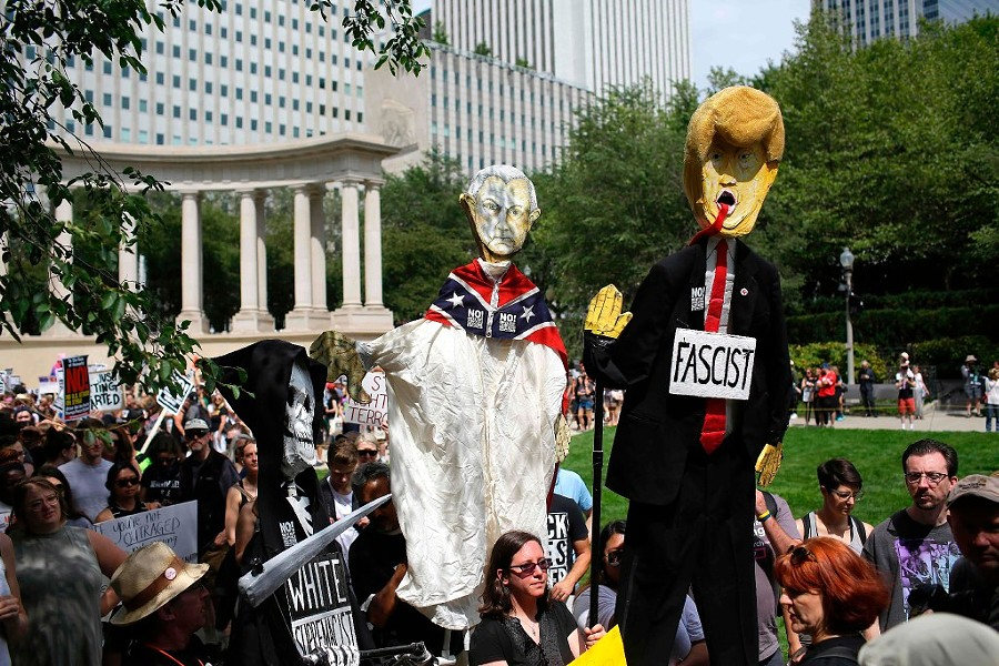 Demonstrators protest against hate, white supremacy groups, and President Donald Trump in Millennium Park Sunday. - JOSHUA LOTT/AFP/GETTY IMAGES
