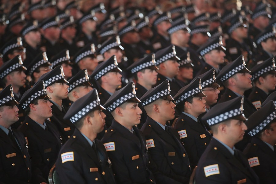Chicago police officers attend a graduation and promotion ceremony in the Grand Ballroom on Navy Pier in June. - PHOTO BY SCOTT OLSON/GETTY IMAGES