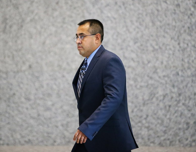 Marco Proano leaves the Dirksen Federal Building on Monday, after a jury found him guilty of unreasonable use of force. - KEVIN TANAKA/FOR THE SUN TIMES