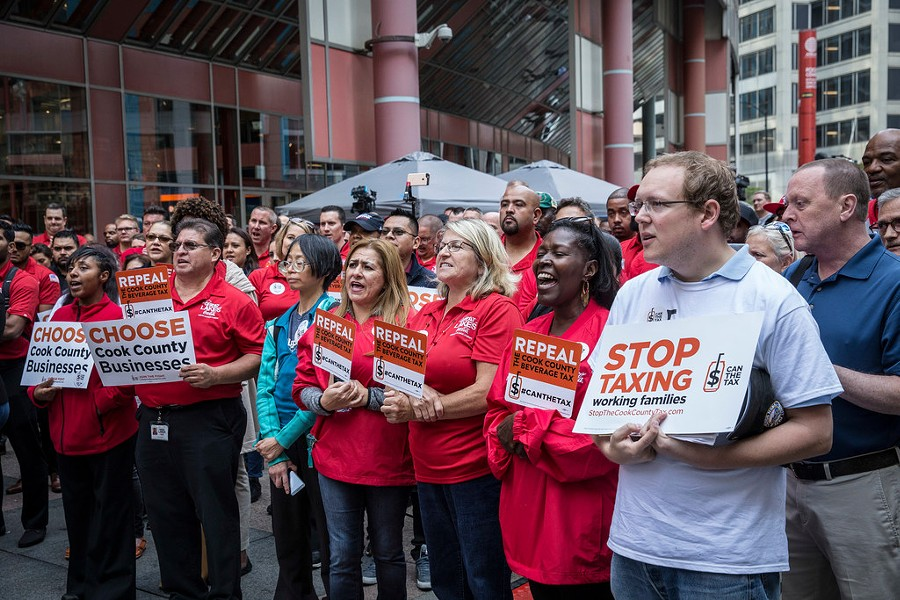 Opponents of the soda tax held a rally outside the Thompson Center Tuesday morning. - RICH HEIN/SUN-TIMES