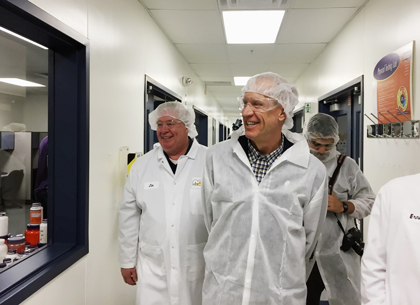 Governor Bruce Rauner tours a factory at Wow Foods in Bloomingdale in April. - AP PHOTO/SARA BURNETT