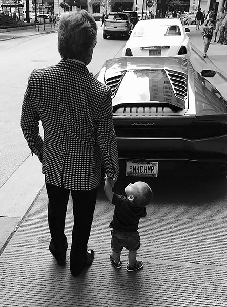 Goldberg with his son, Maximilian, and his Lamborghini in 2016 - COURTESY STUART V. GOLDBERG