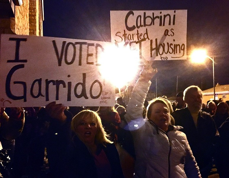 Angry Jefferson Park residents brandished signs supporting Garrido at a protest against a proposed affordable-housing development. - CHICAGO HOUSING INITIATIVE