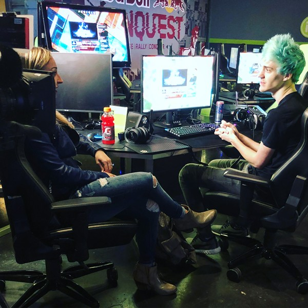 """During the pregame, Ninja visits with his wife, business manager, and fellow streamer Jessica """"JGhosty"""" Goch."""