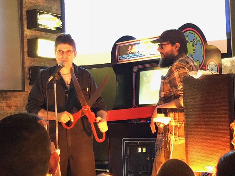Steve Albini cuts the ribbon unveiling Hello Earth, as Logan Arcade's Jim Zespy watches