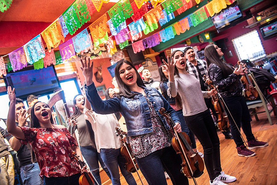 Mariachi Herencia de Mexico perform out of uniform at the Mi Tierra restaurant in Little Village this spring. - CAROLINA SANCHEZ