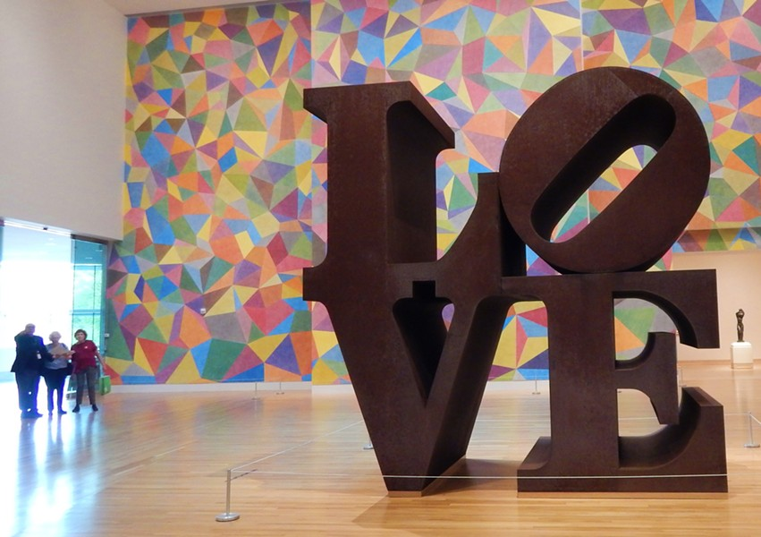 Robert Indiana's Love (1970), backed by Sol LeWitt's wall painting #652 at IMA - DEANNA ISAACS