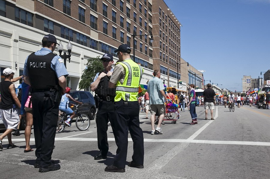 Police watch over a Pride celebration in Lakeview. - SUN-TIMES