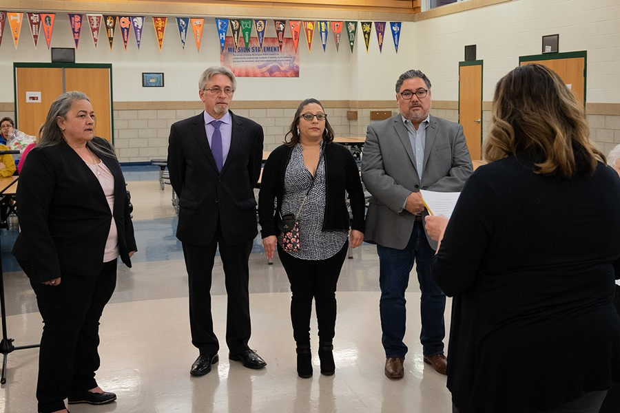 Winifred Rodriguez, Vito Campanile, Olivia Quintero and Jorge Torres are sworn in on April 30 as Lyons Elementary School District 103 board members. Campaign funds controlled by allies of Lyons Mayor Chris Getty spent nearly $20,000 to elect the four to the board. - CASEY TONER/BGA