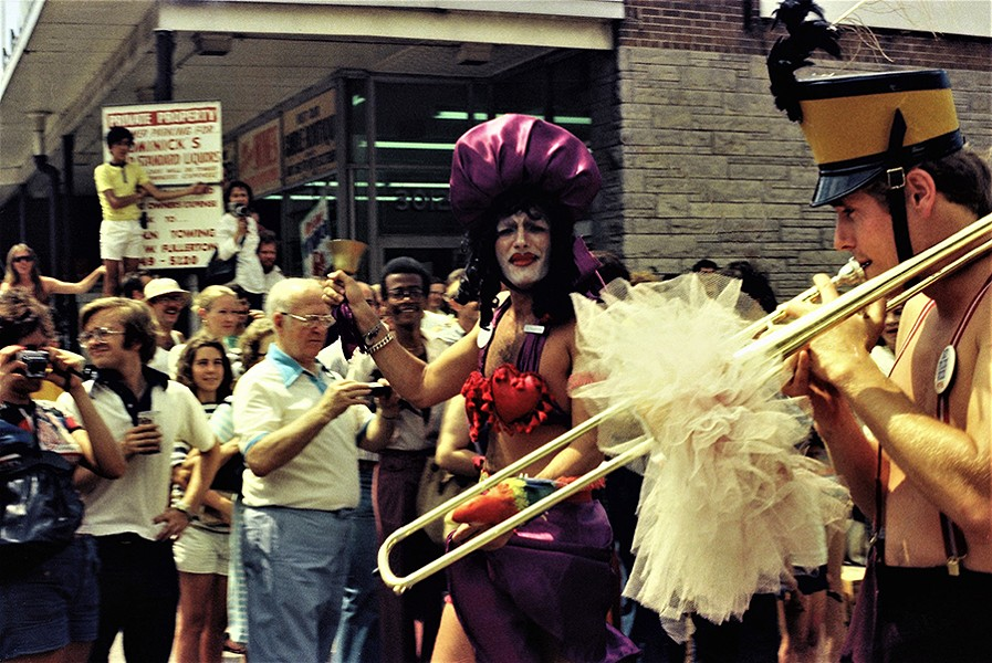 The crowd watches from the vantage point of a Dominick's grocery store while the Pride marchers ring a bell and play a trombone on Broadway. - DIANE ALEXANDER WHITE