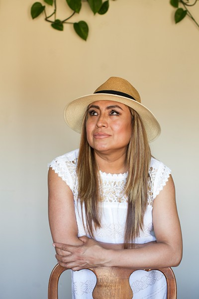 """First, I'm Latina, you can tell I'm indigenous, and then undocumented and transgender,"" Aranda says of how people see her. ""After that, many doors are closed."" - MICHELLE KANAAR"