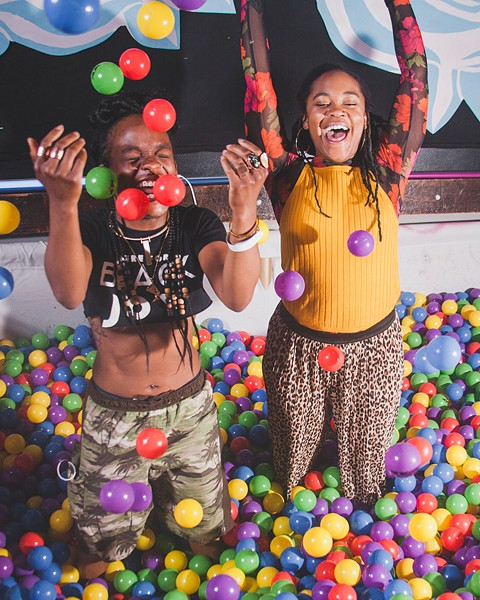Party Noire founders Nick Alder and Rae Chardonnay Taylor in the ball pit at Renaissance One, an event they created in collaboration with Red Bull Presents - ALLY ALMORE