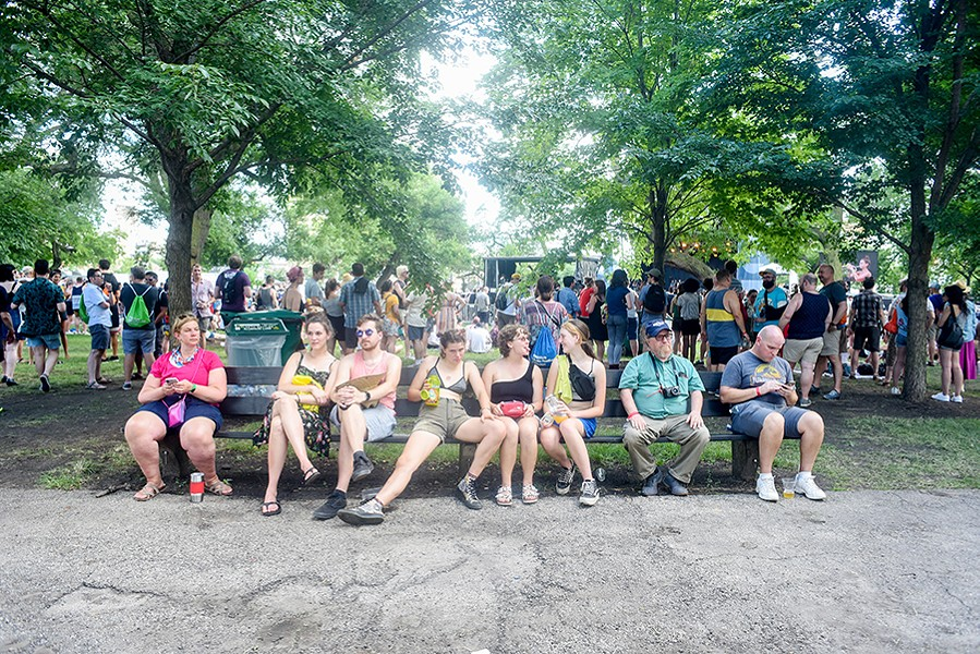 July 19, 2019: Attendees at the Pitchfork Music Festival rest on a bench in Union Park. - KATHLEEN HINKEL