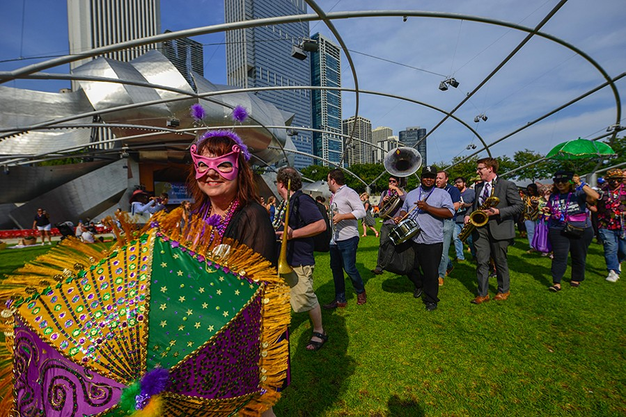 The Mystick Krewe of Laff and the Big Shoulders Brass Band lead a second-line procession at the 2018 Chicago Jazz Festival. - COURTESY DCASE