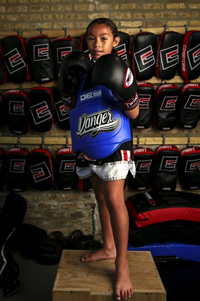 "Chanelle Ortiz, nine, Portage Park Muay Thai - ""I think the kids at school should try this because it's so much fun and I get to go to different places for tournaments and meet new friends. My coaches taught me how to punch and kick, and I think my friends would like to learn that too. It's my favorite thing to do after school."" - GEOFF STELLFOX"