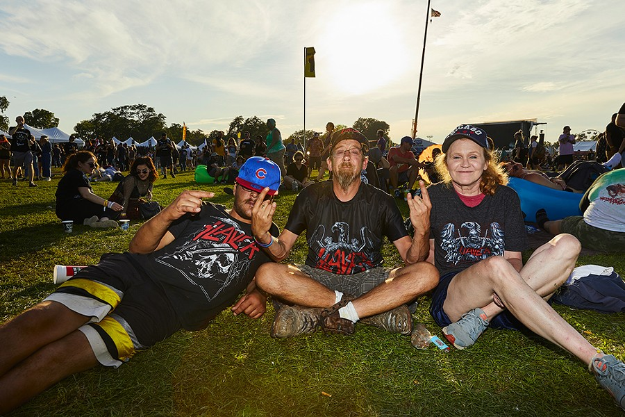 Dro, Bryan, Kimmy (Left to Right).  Bryan has seen Slayer 18 times, the first time at the Aragon in 1990.  He was at Riot Fest to see Slayer's final performance in Chicago. - RYAN SEGEDI