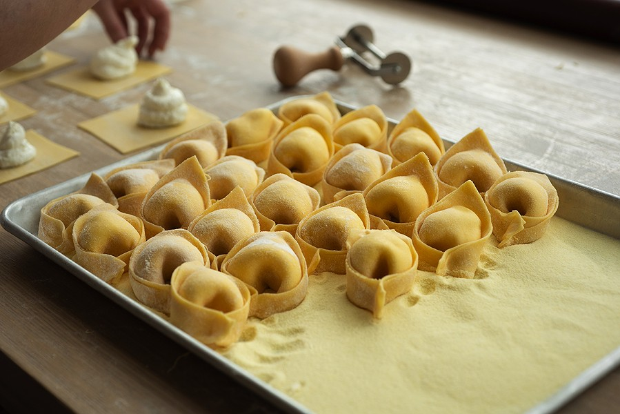 The finished tortelli are set out to dry. At left are squares of dough with the burrata Tortello uses in its signature  dish. - MATTHEW GILSON