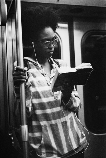 A young woman reads The Autobiography of Malcolm X. - W.D. FLOYD FOR CHICAGO READER