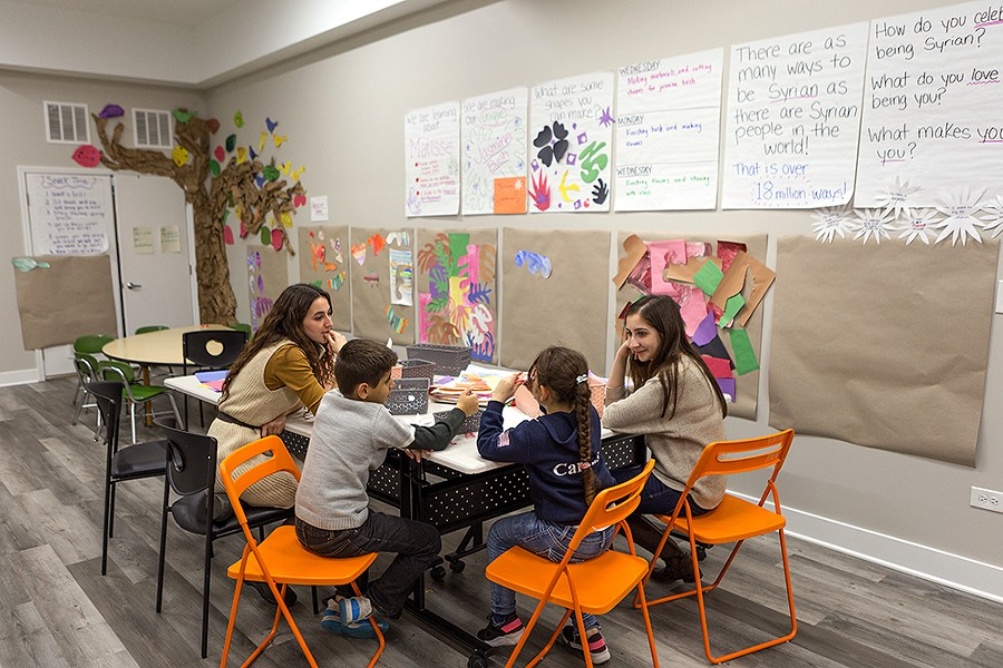 Ms. Amanda and Ms. Sara work with Hamza, 7, and Fatima, 6. - FARAH SALEM FOR CHICAGO READER