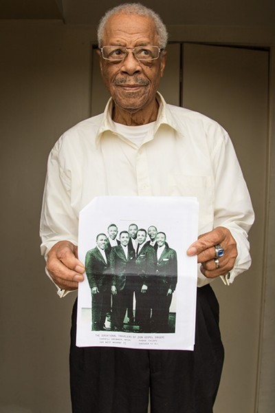Carnell Drummer holds an old photo of his group the Sensational Travelers of Zion, who have a song on No Other Love. Drummer is second from right in the front row. - COURTESY TOMPKINS SQUARE RECORDS