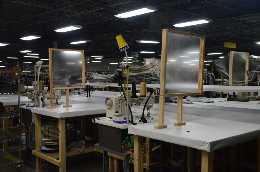 Sewing stations at a RV manufacturing plant in Goshen, Indiana. Dividers were installed after sewers were infected with COVID-19. - LUCAS ROBINSON